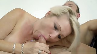 Blonde GILF fucked by a guy yoke times her junior