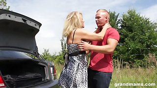 Sexy granny enjoys casual sex with young guy on the side of the road